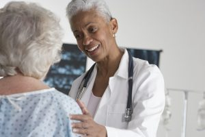 Health Articles - Doctor speaking with patient about the difference between complementary and alternative medicine